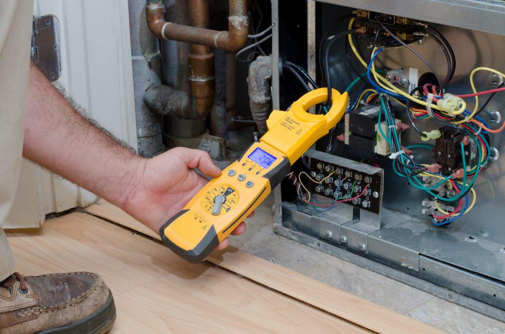 HVAC Tech Servicing AC